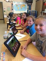 students playing the prodigy math on tablets