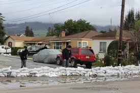 neighbors block flood waters from entering their cul de sac in interlaken with sandbags