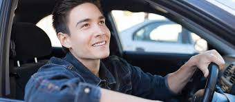 young male driver with arm out car window