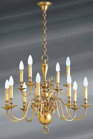 dutch chandelier patinated brass twelve lights lucien gau