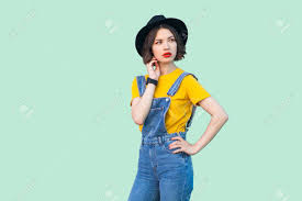 Light Denim Overalls Portrait Of Thoughtful Young Hipster Girl In Blue Denim Overalls