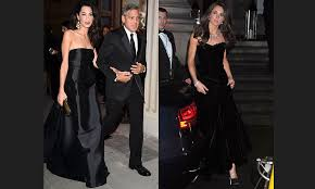 black beauty amal showed off her toned arms at celebrity fight night in florence