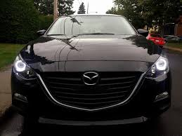 mazda 3 2015 black. imho looks better than flat black plastidip or oem chrome grill badge mazda 3 2015
