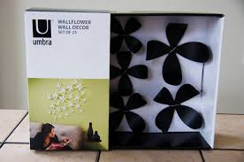 interior cheerful black wallflowers by umbra for white wall