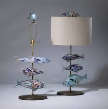 pair of medium blue murano glass fish lamps on distressed brass bases