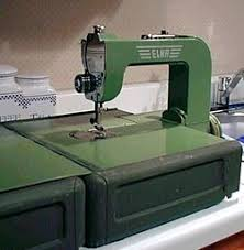 Amy's 1951(?) Elna Grasshopper! & The case opens out into a sewing table that slips around the freearm.The  kneebar is featherlight and folds in half when stored. When winding a  bobbin, ... Adamdwight.com