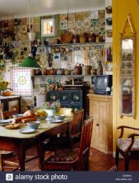 Cottage Kitchen Furniture Old Pine Table And Chairs In Cluttered Cottage Kitchen With Narrow