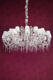 white chrome plated metal and clear crystal designer chandelier masiero