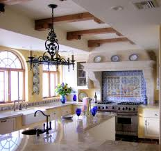 so much to like about this mexican style kitchen . The chandelier is  spectacular ! Handmade tiles can be colour coordinated and customized re.  shape, ...