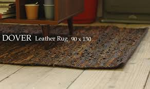 Crowded knitted out making leather products, leather scraps carefully made  recycled leather 100% genuine leather rugs. Moist and smooth leather, ...