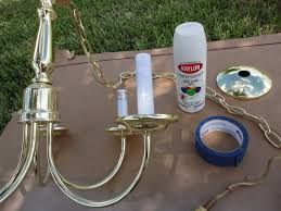 on this brass chandelier i first used krylon semi gloss white spray paint for my base coat
