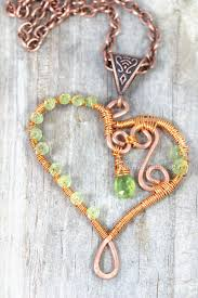 wire wrapped heart pendant in copper wire with peridot birthstone gemstones celtic design bail and