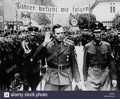 Albert Forster, the Nazi Gauleiter of Gdansk, (middle) takes the salute of  members of the SS-Heimwehr Gdansk, SS-Wachsturmbann Eimann during a meeting  of the District Leader of the NSDAP in the Free