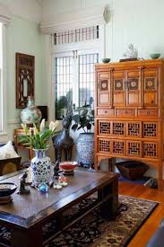 Living Room With Asian Style Home Decor And Coffee Table And Rug And  Sideboard And Console