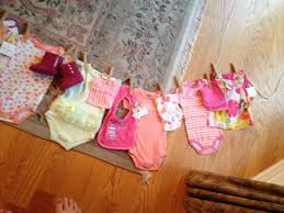 Clothes line baby shower gift. Hang items like laundry on a line. Attach  with
