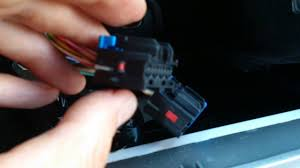 2010 chevrolet malibu radio removing wire harness youtube how to remove pins from molex connector at Removing Wires From Harness