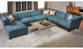 U Shape Blue Suede Tufted Sectional Sofa With Right Chaise Lounge Using  Black Acrylic Legs Placed