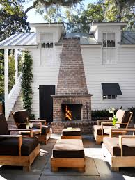 build your own outdoor fireplace designs with padded wooden chairs two square tables on concrete flooring