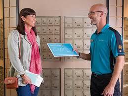 open residential mailboxes. Associate Handing Mail To Customer Open Residential Mailboxes
