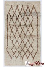 taupe colored moroccan berber beni ourain design rug with brown diamond shaped patterns handmade 100 wool