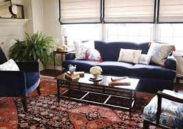 red rugs for living room living room navy sofa and chairs red pattern rug living red