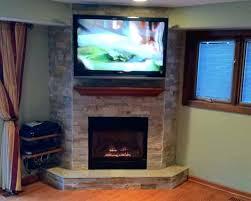 corner fireplace mantel with tv above corner fireplace with above fireplaces