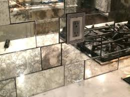 antiqued mirror glass as a beautiful back splash antiqued mirrored glass door panels