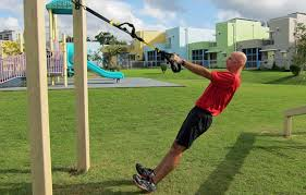 upper pull exercise suspension trainer rows face the bar and lean back with the suspension cables in your hands pull yourself up bending the elbows to