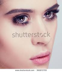 beautiful woman with bright make up eye with y black lashes makeup chic evening make