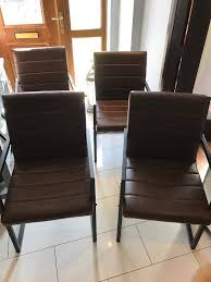 brown dining chairs. 4 Brown Faux Leather Dining Chairs