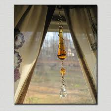 amber raindrop crystal cut prism eye catcher image