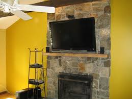how to install stacked stone over brick fireplace design