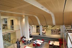 Curving ceiling representing rolling wave at SCEGG built with Decor Systems  ceiling panels