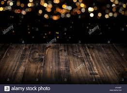 black wood table top. Rustic Wooden Table Top With Blurred Lights In Black Background Wood