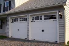 malibu design 16 x 8 craftsman solid paint grade wood garage door