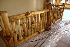 Hand cut tenons, metal balusters, decorative metal inserts, burlwood & tree  branch railings