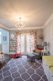 Modern bright colorful playroom. Floral curtains, stenciled wall.