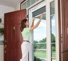 retractable screen storm doors offer