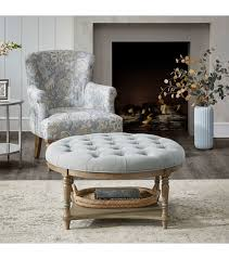 round grey fabric tufted coffee table