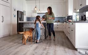 a mom child and the family dog enjoying a durable beautiful vinyl floor in