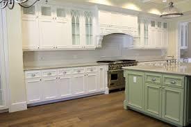 Simple kitchen design using square light green wood kitchen island  including white granite kitchen