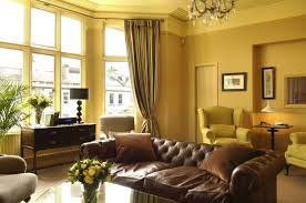 epic decorating ideas using round black desk lamps and grey loose curtains also with rectangular brown