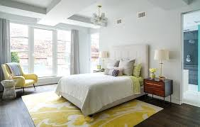area rugs for bedroom lovely yellow and white bedroom with an armchair and pendant lighting featuring