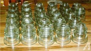 32 vintage clear glass insulators