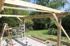header bracing provides ility first pergola joists in and braced