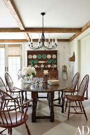 a contemporary oak dining table is paired with windsor chairs from nantucket house in the family
