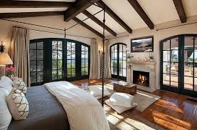 luxury master bedrooms with fireplaces. Unique Fireplaces Luxurymediterraneanmasterbedroomwithfireplace Frenchdoorsandwoodflooring On Luxury Master Bedrooms With Fireplaces R
