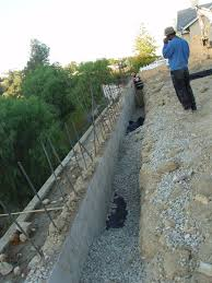 build retaining wall to widen back yard for custom home in west covina