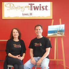 the grand opening for painting with a twist is wednesday april 6 sitting in front of the artist stage are owners lania and john peterson by chris flood