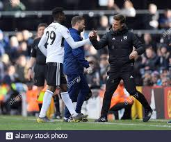 Soccer Football - Premier League - Fulham v Everton - Craven Cottage,  London, Britain - April 13, 2019 Fulham's Andre-Frank Zambo Anguissa shakes  hands with Fulham caretaker manager Scott Parker as he